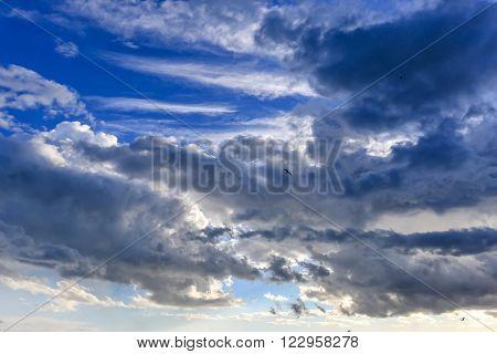 Big powerful dark storm clouds at summer