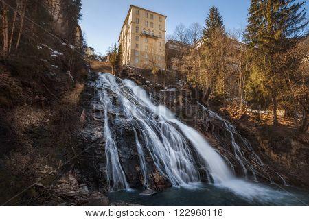 Waterfall in Mountains ski resort Bad Gastein Austria - nature background.