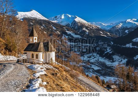 Chapel in the mountains overlooking the town of Bad Gastein. Austria.