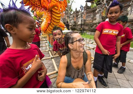 UBUD, BALI - MAR 8, 2016: Unidentified children during the celebration before Nyepi - Balinese Day of Silence. Day Nyepi is also celebrated as New Year - according Balinese calendar now came 1938 year