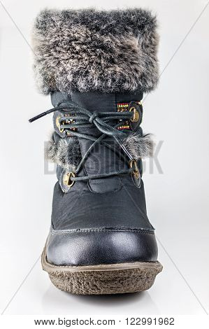 Winter female boot with fur isolated over white Stack focus