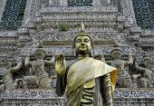 Golden buddha statue at Wat Arun the Temple of the Dawn also known as Wat Chaeng in Thonburi Bangkok Thailand. poster