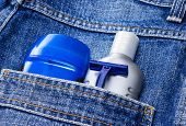 Mens cosmetics. Antiperspirant deodorant, aftershave lotion and disposable razor in jeans pocket. Basic skin care cosmetic products and accessories for men. Toiletry and cosmetic travel kit poster