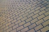 Full frame brick pavement close up from skewed low tilted angle in horizontal 3:2 format. poster