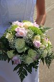 Bride holding her bridal bouquet ivory roses and pink fresia poster