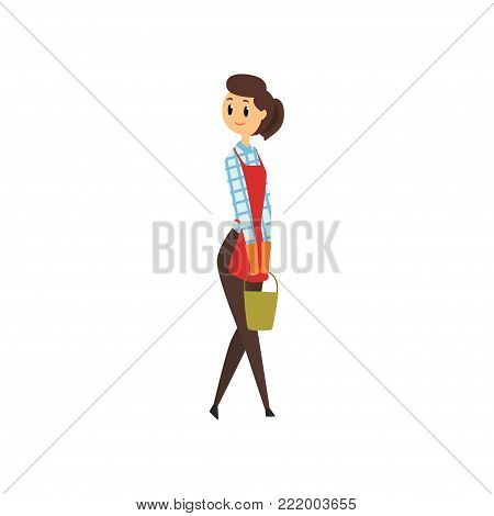 Cheerful maid standign with green bucket in hands. Domestic housekeeping. Cleaning service. Girl in in brouse, pants, apron and rubber gloves. Flat vector illustration isolated on white background.