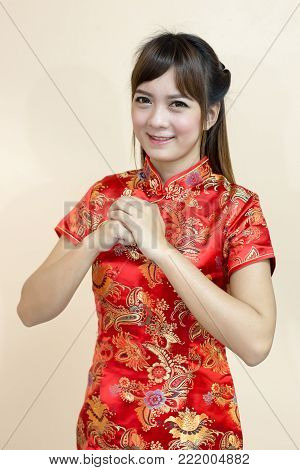 Closeup Of Asian Woman Greeting In Traditional Chinese Or Cheongsam With Pearl In Chinese New Year C