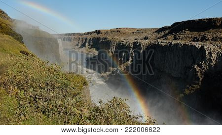 Double rainbow over the canyon near the Dettifors Waterfall