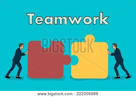 Teamwork. two businessmen connect the two parts of the puzzle into one