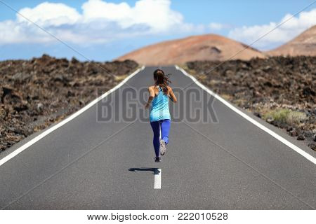 Running athlete woman runner sport fitness lifestyle - Cardio jogging workout girl training outdoors on road.