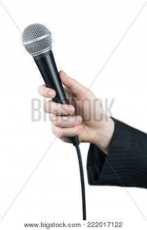 Close up of man's hand holding microphone isolated on white background