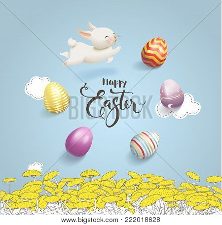 Happy Easter inscription handwritten with calligraphic font surrounded by colorful decorative eggs and cute white rabbit, dandelion field and blue sky with clouds on background. Vector illustration.