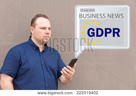 GDPR Message received an e-mail online on a mobile phone.  Sending Message online . The concept of familiarization of people with the GDPR