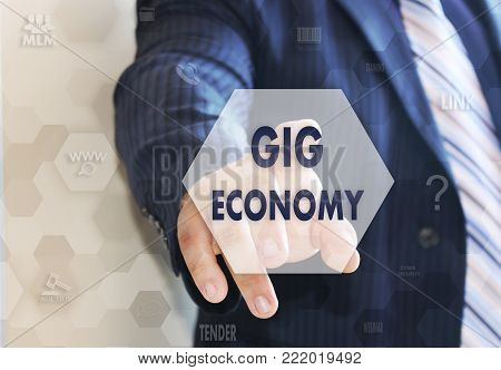 The businessman chooses the GIG ECONOMY on the touch screen.
