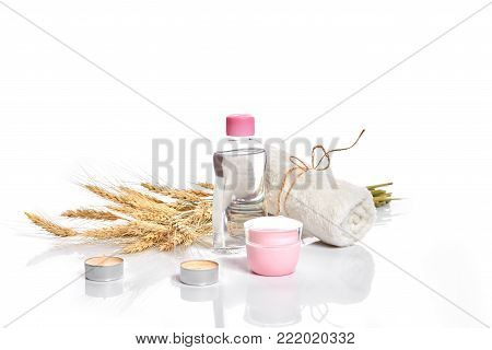 Herbal and mineral skincare. Jar of cream, oil with wheat, cosmetic bottles. Without label. The concept for advertising cosmetics. Still life. Copy space