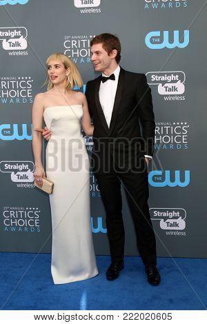 LOS ANGELES - JAN 11:  Emma Roberts, Evan Peters at the 23rd Annual Critics' Choice Awards at Barker Hanger on January 11, 2018 in Santa Monica, CA