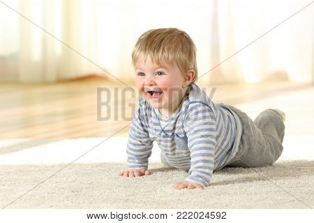 Portrait of a happy baby crawling on a carpet at home