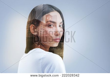 City landmark. Appealing charming earnest woman  asking for help while staring at the camera and posing against isolated background
