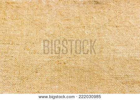 Background of a burlap made of natural coarse unpainted spinning fibers from hemp