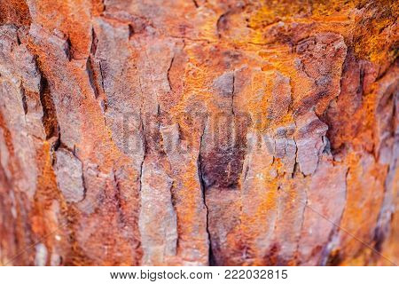 Old rusted corrosion metal surface as red and orange cracked oxidized iron background, decay obsolete texture concept