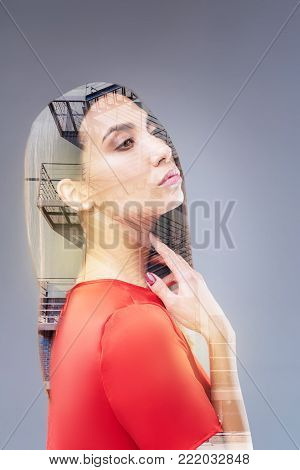 Moving forward. Wistful gorgeous nice woman looking confident while creating future and touching her neck