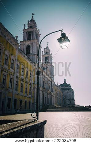 Side view of Mafra Palace and Cathedral with street light pole