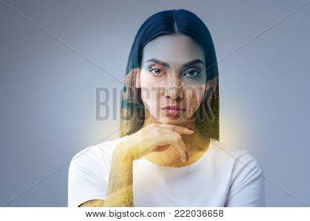 My brainstorm. Wistful beautiful nice woman gazing straight and placing head on the finger and reconsidering chances