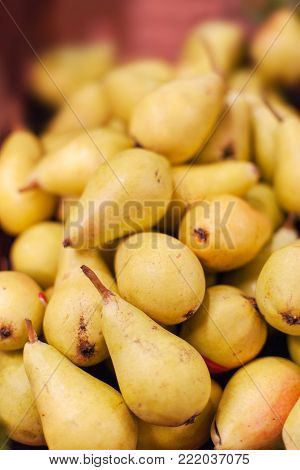 Pear texture - Organic Ripe pears fruit  in the market.  Pears harvest.  Food background