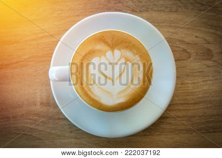 Bean Coffee With Latte Art Or Cappuccino On Wooden Table