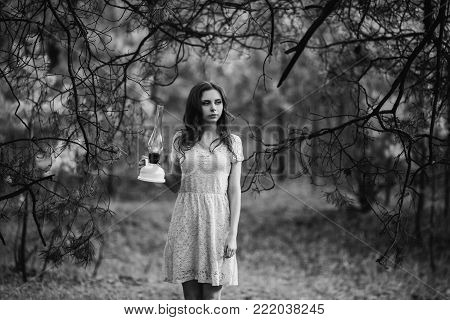 Doll appearance. Black and white art monochrome photography. Black and white creative photography. Black and white conceptual image. Beautiful black and white background. Black and white portrait.