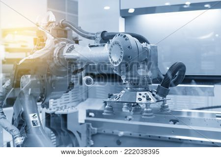The robot for metal forming process in light blue scene.Modern factory for industrial 4.0 manufacturing process.