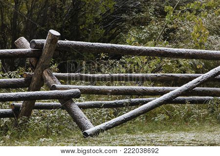 light snow on wood rail fence on Wyoming ranch