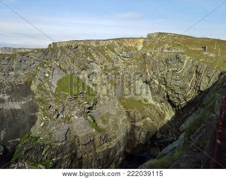 Mizen Head Rock Strata Cliffs with Green Grass