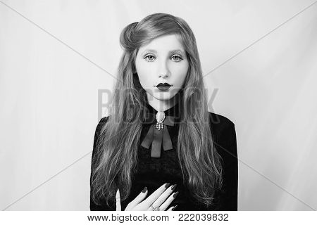 Black and white art monochrome photography. Black and white creative photography. Black and white conceptual image. Beautiful black and white background. Black and white portrait. Woman with straight hair wearing a black dress