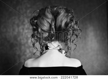 Woman with beautiful hairstyle standing back. Black and white art monochrome photography. Black and white creative photography. Black and white conceptual image. Beautiful black and white background. Black and white portrait.
