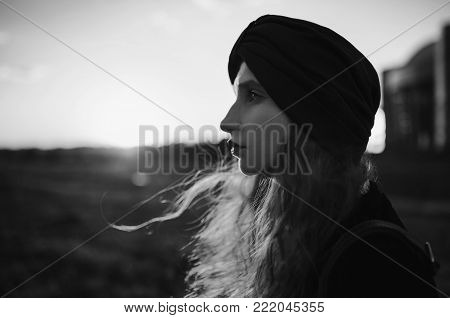 Black and white art monochrome photography. Black and white creative photography. Black and white conceptual image. Beautiful black and white background. Black and white portrait. A woman with pale skin and long hair in a black coat