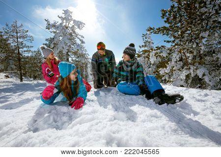 Ski, snow sun and fun - happy family on ski holiday
