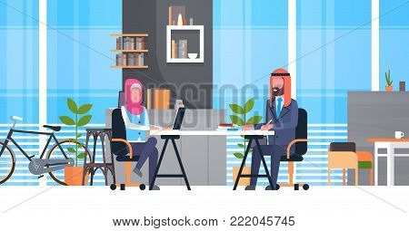 Arabic Business Man And Woman Sitting At Office Desk In Modern Coworking Space Working Together Muslim Workers In Coworkers Center Flat Vector Illustration