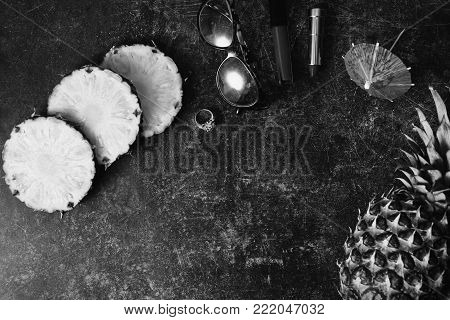 Ripe pineapple and cocktail umbrellas. Black and white art monochrome photography. Black and white creative photography. Black and white conceptual image. Beautiful black and white background.