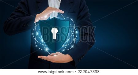 Businessmen shake hands to protect information in cyberspace. Businessman holding shield protect icon protection network security computer and safe your data concept, Space input data