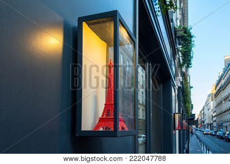 Red Eiffel tower glass display case in Paris