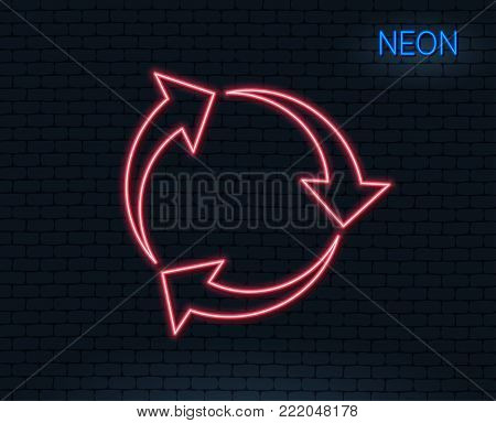 Neon light. Recycle arrow line icon. Recycling waste symbol. Reduce and Reuse sign. Glowing graphic design. Brick wall. Vector