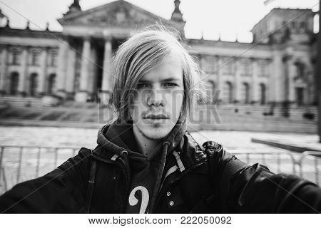 Black and white art monochrome photography. Black and white creative photography. Black and white conceptual image. Beautiful black and white background. Black and white portrait. Selfies Photo Man with blond hair on the background of the Reichstag in Ber