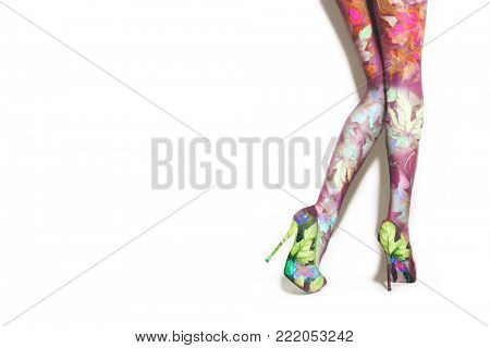 woman legs in high heel shoes photo compilation with leaves  on white background