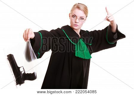 Law court or justice concept. Emotional woman polish lawyer attorney holding weapon gun - bag marked evidence of crime,  wagging her finger.  Isolated on white background.