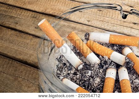 Smoke ashtray ash tray cigarettes background nobody
