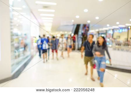 Blurred image of people walking to shopping at department store