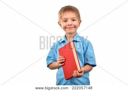 A boy with a book. A boy at school. A good mood. An isolated boy.