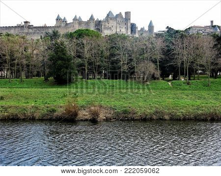 View of the old walled city of Carcassonne across the River Aude, France