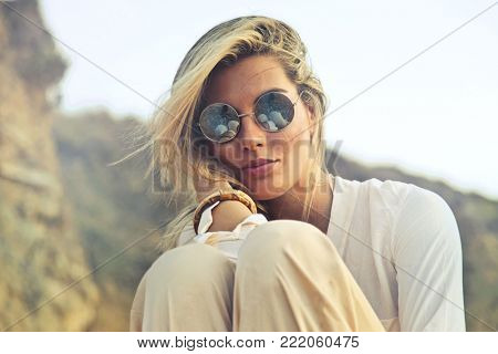 Beautiful woman wearing beautiful sunglasses